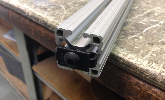 An end fastener is loaded into the end of the aluminum extrusion profile.